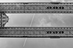 Tower Bridge - Watch The Watchers by Simon & His Camera (On Explore 21st Apr 2016) (Simon & His Camera) Tags: city bridge sky urban blackandwhite bw building london tower monochrome lines skyline architecture composition pattern outdoor trails vertigo lookingup explore iconic simonandhiscamera