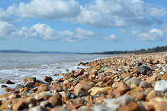 Calshot (crhobbs89) Tags: sea sky sun holiday beach wet water sand peace stones sunny huts solent april