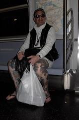 Untitled (Brian Barbieri) Tags: tattoo flash streetphotography environmental glam newyorksubway genderbender leicax2