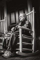 Man in the Chair (sintualex) Tags: man monochrome reflecting chair alone sitting loneliness candid streetphotography peaceful sombre elderly thinking ricohgr pondering observing facialexpression