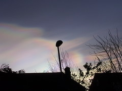 Nacreous clouds (Nekoglyph) Tags: winter sky clouds rainbow spectrum bright roofs colourful stratosphere motherofpearl nacreous