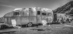 Endless Vacation (magnetic_red) Tags: camping truck junk rust aluminum desert chairs antique nevada lawn rusted openroad trailer van camper americanwest