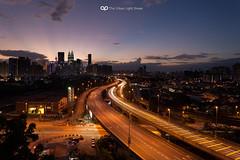 The Urban Light Streak (acidsulfurik) Tags: sunset skyline canon long exposure cityscape traffic malaysia lighttrails kualalumpur kl vantagepoint digitalblending jelatek manfrotto190cxpro4 5dmkii 5dmk2