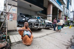 5D8_7214 (bandashing) Tags: poverty old england car manchester sharif women jeep poor gas showroom toyota vehicle meter juxtaposition sylhet bangladesh mitsubishi socialdocumentary dargah aoa shahjalal bandashing akhtarowaisahmed
