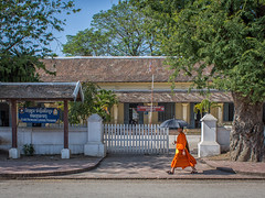 Monk and school stride-by (Man+machine) Tags: street travel school monk laos luangprabang buddhistmonk