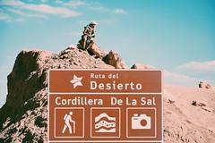 Conqueror (Mara Sanguinetti) Tags: chile boy sun nature analog landscape desert natural paisaje atacama overexposed desierto backpacker insight sudamerica sanpedrodeatacama hitchicker wonderlust wonderer