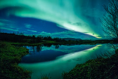 Aurora borealis reflecting off a lake (jamenpercy) Tags: santa christmas trip travel trees winter sea vacation lake holiday reflection green nature beauty norway forest finland river stars wonder lights solar iceland stream break natural sweden space lappland north freezing science pole arctic galaxy journey aurora lapland stunning nordic wilderness scandinavia northern universe northernlights borealis tromso phenomenon phenomena geomagnetic