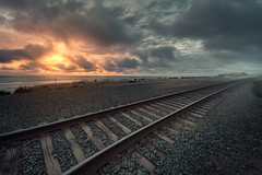 Hazy Substance (David Colombo Photography) Tags: ocean california railroad sunset sky mist fog clouds train landscape coast nikon rocks pacific outdoor path traintracks foggy tracks atmosphere rail explore coastal westcoast delmar d800 leadinglines explored davidcolombo davidcolombophotography
