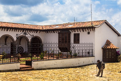 Guatavita (Macarena V) Tags: old blue sky man hat cane azul town colombia bogot pueblo cielo sombrero anciano poncho hombre bastn guatavita