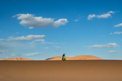 INSHALLAH (DanielO'Donnell & AbiPonceHardy) Tags: africa travel blue sky orange man travelling sahara beauty golden sand nikon alone desert horizon tranquility morocco silence nomad linear merzouga travelphotography
