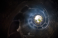 Looking Up from the Initiation Well of Quinta da Regaleira (fesign) Tags: old history portugal horizontal architecture spiral outdoors photography moss ancient day arch quintadaregaleira sintra tranquility nopeople unescoworldheritagesite well traveldestinations initiationwell colourimage builtstructure traditionallyportuguese