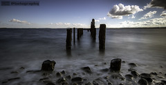 Cunningburn (C.M_Photography) Tags: longexposure blue ireland cloud long lough day jetty ruin pebbles northernireland stumps strangford newtownards 10stop haidafilter