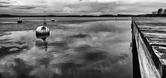 Finnish spring (KariFinland) Tags: lake canon blackwhite spring dock 1d ballard 14mm samyang