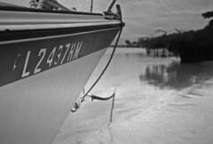 Another Derelict (PositiveAboutNegatives) Tags: abandoned film beach sailboat analog 35mm boat florida empty rangefinder wideangle jupiter12 derelict coolscan foma aristaedu shap fomapan contaxii kiev2a zeissbiogon nikon9000scanner