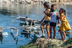 Girls Playing Near Fishing Boat, Cebu Philippines (AdamCohn) Tags: girls girl laughing philippines cebu cebucity fishingboat slum slums shacks adamcohn wwwadamcohncom ybanezcompound
