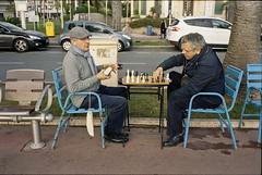 Chess Players - Cannes - France (waex99) Tags: leica xmas famille game france men nice riviera play kodak cannes board chess noel player dec epson cote portra summilux m6 hommes azur 400iso croisette jeux joueur jouer mediterranee 2015 echec v500