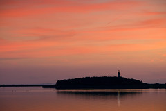 A Light in the Dusk (parkerbernd) Tags: ocean light sunset red sea sky lighthouse reflection water silhouette clouds germany lumix dusk peaceful calm baltic fehmarn gx1 fluegge