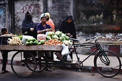 Vegetable Hole (N A Y E E M) Tags: street morning vegetables kid women hijab vendor bangladesh seller carwindow burqa chittagong rickshawvan navalavenue