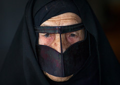an old bandari woman wearing a traditional mask called the burqa, Qeshm Island, Salakh, Iran (Eric Lafforgue) Tags: portrait people woman horizontal closeup outdoors photography clothing asia veil mask iran muslim islam traditional religion hijab indigo persia headshot hidden identity human elderly covered iranian adults adultsonly oneperson islamic burqa ethnicity frontview persiangulf sunni elderlywoman qeshmisland chador darkbackground hormozgan onewomanonly lookingatcamera burqua  bandari  blackveil 1people  iro straitofhormuz  colourpicture  salakh borqe boregheh iran034i0845