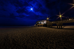 Gulf Shores Pier (Mark Wingfield) Tags: park blue moon beach night clouds dark outside outdoors evening pier fishing lowlight sand nikon gulf state low alabama iso shores 8mm d610 rokinon