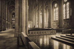 Grace Cathedral no. 3 (Michael Evans) Tags: sanfrancisco california wood windows light shadow blackandwhite bw sun church sepia architecture concrete religious blackwhite solitude candle arch peace cathedral spirit interior basilica religion stainedglass christian soul column marble ornate toned sanctuary episcopal gracecathedral frenchgothic lecturn houseofworship lewisphobart janhenrykderosen