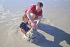 Father and son sand castle