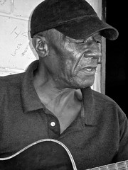 the last of the bentonia bluesmen ... 'EXPLORED' ~ #23 ~ WATCH: (Shein Die) Tags: portrait blackandwhite bw music grey candid streetphotography streetscene explore guitarists bluesmen explored inexplore bluefrontcafe jimmyholmes jimmyduckholmes