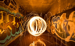 Floating orb in abandoned tunnel (Jordan Jozwiak) Tags: light abstract reflection abandoned wool water night painting steel orb tunnel indoor desolate steelwool