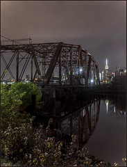**IN THE STILLNESS OF THE NIGHT** (**THAT KID RICH**) Tags: nyc nightphotography bridge trees ny green water night canon reflections river landscape sill shadows decay manhattan landmark explore queens esb empire empirestatebuilding wtc iconic active 5dm2 richzoeller richardzoeller
