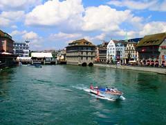 zurich (Sergiu St. O.) Tags: water clouds switzerland cityscape zurich motorboat elvetia policeboat limmatriver