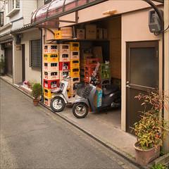 kyoto-0841-ps-w (pw-pix) Tags: street houses windows plants japan buildings concrete kyoto doors bottles backstreet pots drinks scooters gion asphalt kerb shelves bitumen stacked crtes rearofshops