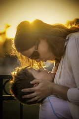 A mother's love... (Allan James Fisher) Tags: sunset love nikon kiss candid mother 85mm son backlit tender