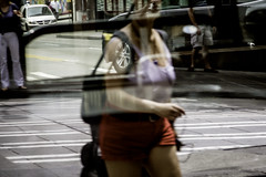 Why Can't We All Move Forward Together? (Paradise.Found) Tags: life seattle street city light shadow red people urban woman usa blur reflection art strange perception flickr shadows candid curves culture streetphotography documentary social depthoffield human essential environment shorts sight framing unposed society critical interference insight reference decisivemoment observer 200mm interpretive streetphotographer descriptive paradisefound alienskinexposure pentax135mm streettogs miltongarrisonphotography