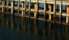 Ponder... (dawn.tranter) Tags: ocean reflections jetty sunlightonwater warmlight reflectedwaters dawntranter