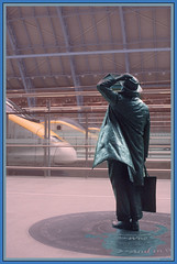 Sing on, with hymns uproarious, Ye humble and aloof, Look up! and oh how glorious He has restored the roof!  (Betjeman, 1931) (Keith Halton) Tags: london art station statue poetry eurostar trains unusual stpancras johnbetjeman
