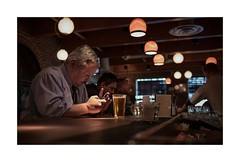 Connecting ? (sorrellbruce) Tags: bar pub alone fuji phone cell lonely socializing solitary connection highiso lr6 photoninja colorefexpro framefun fujinon23mm fujixt1 thomasfitzgeraldpresets