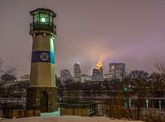 Boom Island Lighthouse (Greg Riekens) Tags: city winter usa lighthouse snow cold minnesota fog skyline night dark downtown foggy minneapolis mississippiriver boomisland flickrelite nikond7000