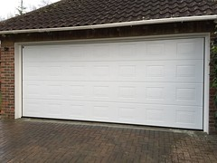 Big conversion of two single opening garage doors into one big Hormann Georgian sectional in West Chiltington