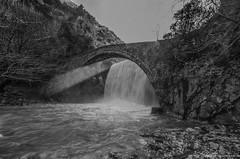 Ray of Sun under Bridge (NikosPesma) Tags: bridge blackandwhite bw sun water monochrome river landscape waterfall outdoor greece stonebridge archbridge rayofsun thessaly                   palaiokarya