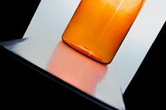 Shrunken plastic bank (Alexander Pugatschewski) Tags: blue shadow red stilllife orange white distortion black reflection green yellow modern contemporary background object container plastic abstraction transparent defect slope diagona ltilt