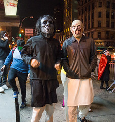 Looking for Trouble? (UrbanphotoZ) Tags: nyc newyorkcity ny newyork halloween downtown fighter manhattan butcher masks cape westside mummy halloweenparade canalst dunkindonuts shrunkenhead disfigured leprechaunsuperman