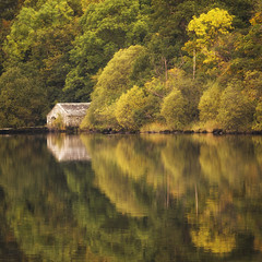 Boat House Squared (Vemsteroo) Tags: morning autumn trees orange lake reflection nature beautiful forest sunrise canon square landscape outdoors still warm exploring shoreline lakedistrict cumbria 5d serene colourful boathouse tranquil 70200mm ullswater glenridding mkiii circularpolariser leefilters