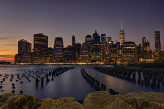 Lower Manhattan HDR (bprice0715) Tags: city nyc longexposure travel sunset sky urban water architecture night clouds canon buildings evening colorful cityscape nightlights manhattan lowermanhattan leadinglines canoneos5dmarkiii canon5dmarkiii