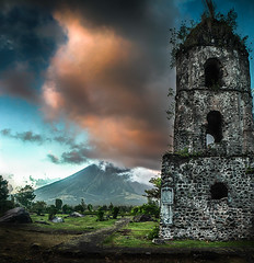 Cagsawa ruins in the shade of Mayon Volcano. Philippines. (mariuszbarwinski) Tags: sunset tower church clouds volcano ruins destruction philippines disaster mayon bicol eruption cagsaua cagsawa daraga legazpi albay activevolcano kagsawa mariuszbarwinski barwinskimariuszgmailcom mariuszbarwinskicom