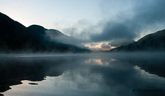 Morning Haze reflection #4 - Secret serenity (Princessa Pea) Tags: lake reflection silhouette clouds sunrise 2011 earlymorninglight 5633
