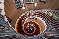 Afterglow (Otto Berkeley) Tags: city uk england urban building london fall architecture stairs spiral lights vanishingpoint britain interior steps descent lookdown departmentstore journey staircase round below curved pendant heals cecilbrewer brewerstaircase