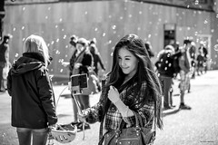 Bubbly Smile (Silver Machine) Tags: street portrait bw girl monochrome smile mono blackwhite candid streetphotography streetportrait bubbles oxford canoneos oxfordshire selfie canon600d selfiestick canonef50mmf18stm