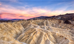 Zabriskie Point, Death Valley NP (x-ray tech) Tags: light sky terrain cloud hot color rock canon interestingness nice interesting twilight colorful warm desert angle dusk vibrant wide rocky vivid dry explore level deathvalley badlands capture depth harsh 5dmarkii