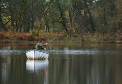 Loch Rusky (Alec-Gibson) Tags: trees water reflections scotland boat fisherman loch lochrusky