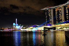 Marina Bay Lights_1772 (Stephen Wilcox - Jetwashphotos.com) Tags: ocean travel sea color colour reflection building tourism water architecture night buildings mall photography lights hotel evening bay harbor singapore flickr rooms waterfront image harbour ripple transport beam photograph transportation laser ripples laserbeam wp lightshow innerharbour marinabay marinacentre luxuryhotel helixbridge singaporeflyer marinabaysands artsciencemuseum jetwashphotos